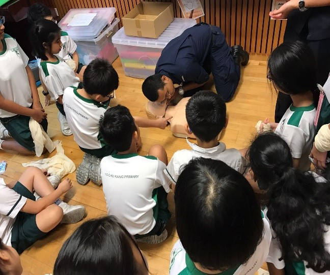 SCDF officer showed pupils the correct way of doing the CPR