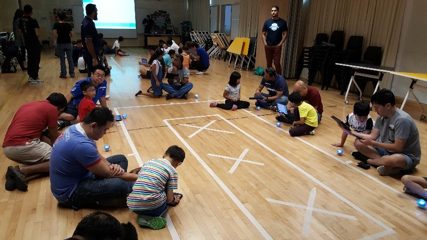 """drag, aim, sphero!"" father-child bonding event - engaged in programming the Sphero ball"