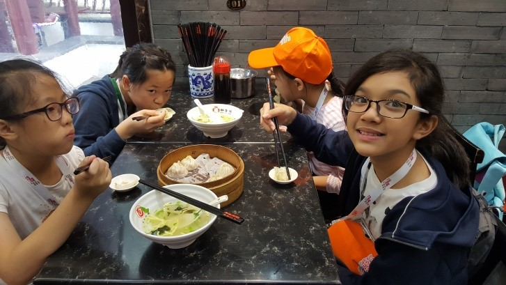 Enjoying ourselves and tasting delicious Shanghai dumplings at Qi Bao Ancient Town.1.jpg